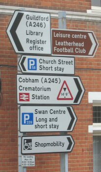11 Apr 04: Leret Way (Insitute): detail of signs as seen from Epsom Road at tl